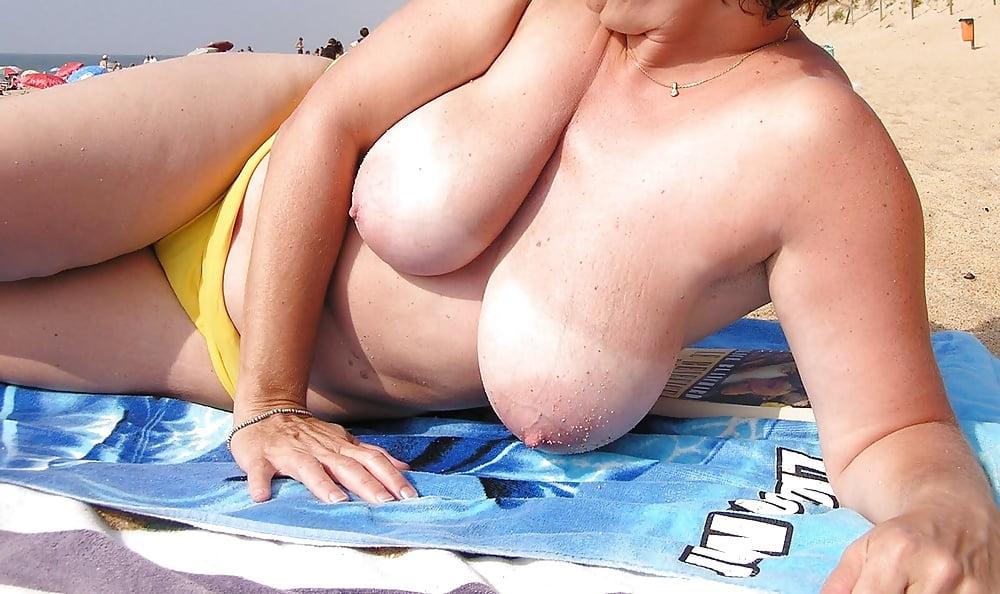 Big boob beach girl