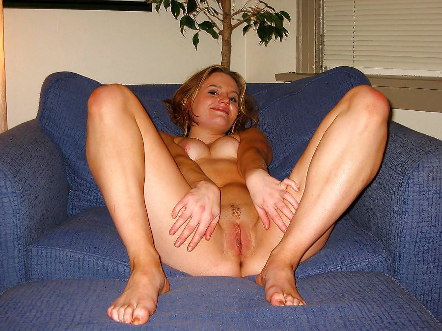 Amateur Chick Stripping And Spreading Her Pussy