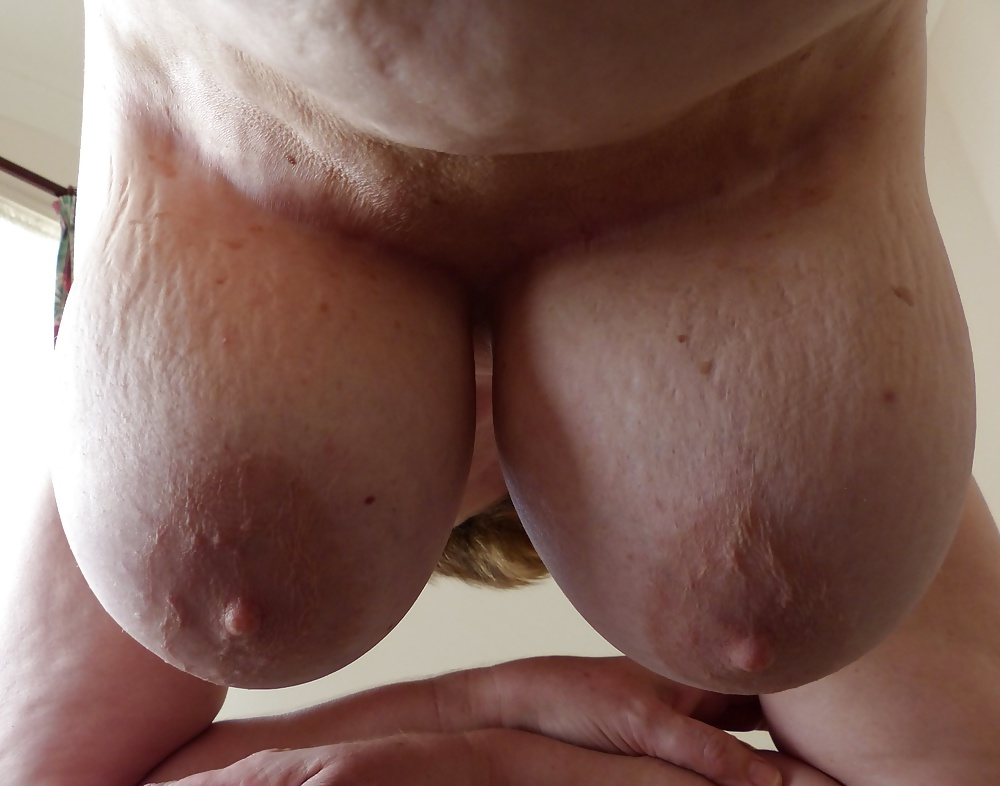 Hand stretched tit nude 12