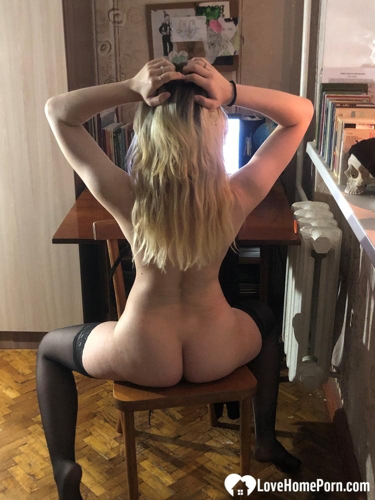 Hot blonde in stockings strips her lingerie