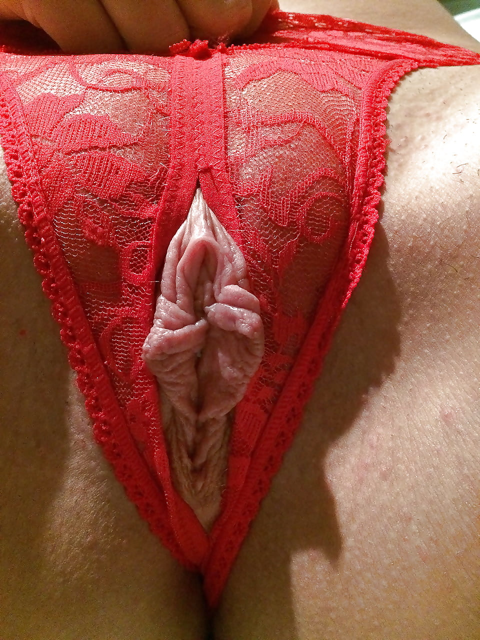 Lacy red panties pulled off to get some doggy style