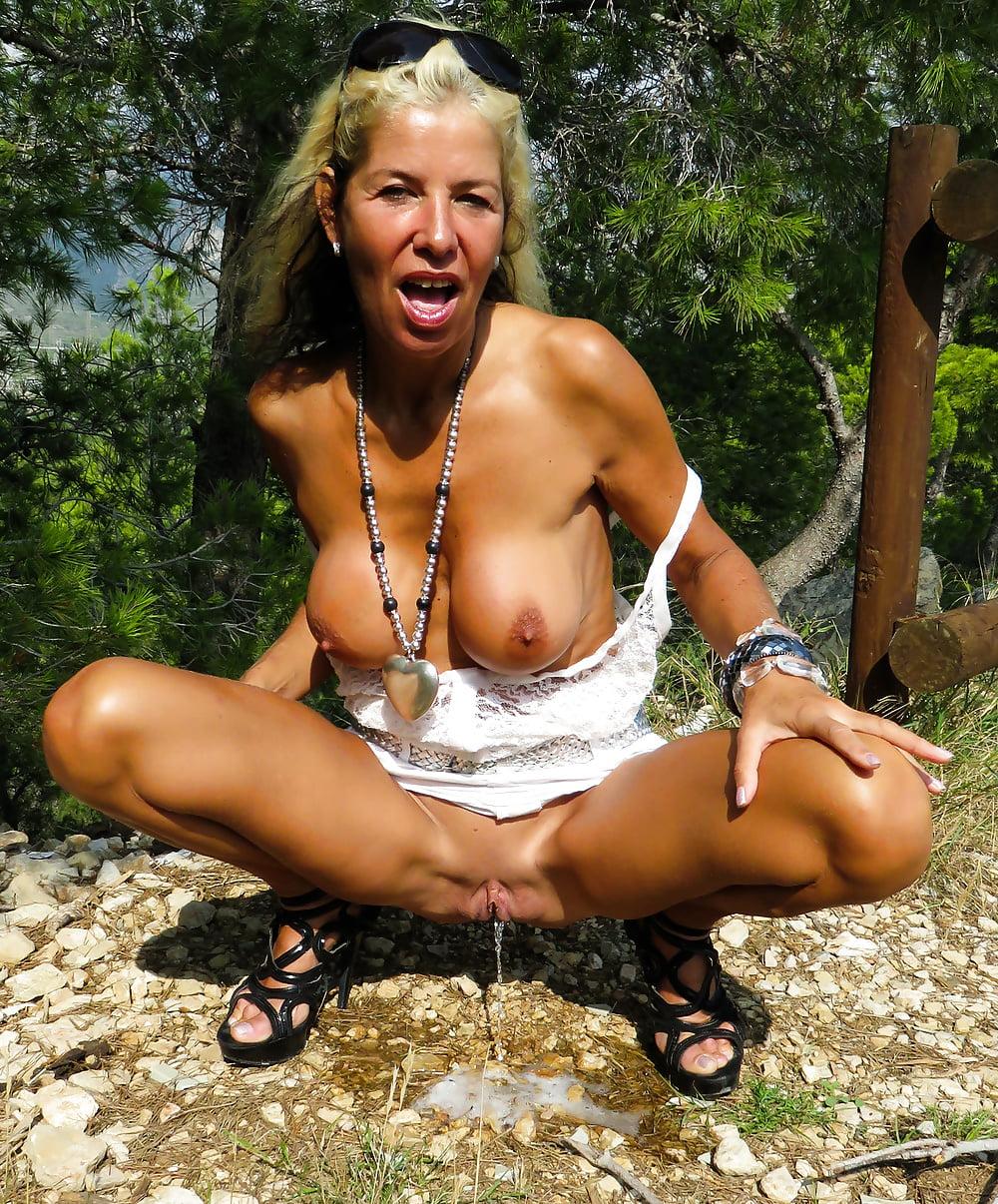 Old slut pissing in nature