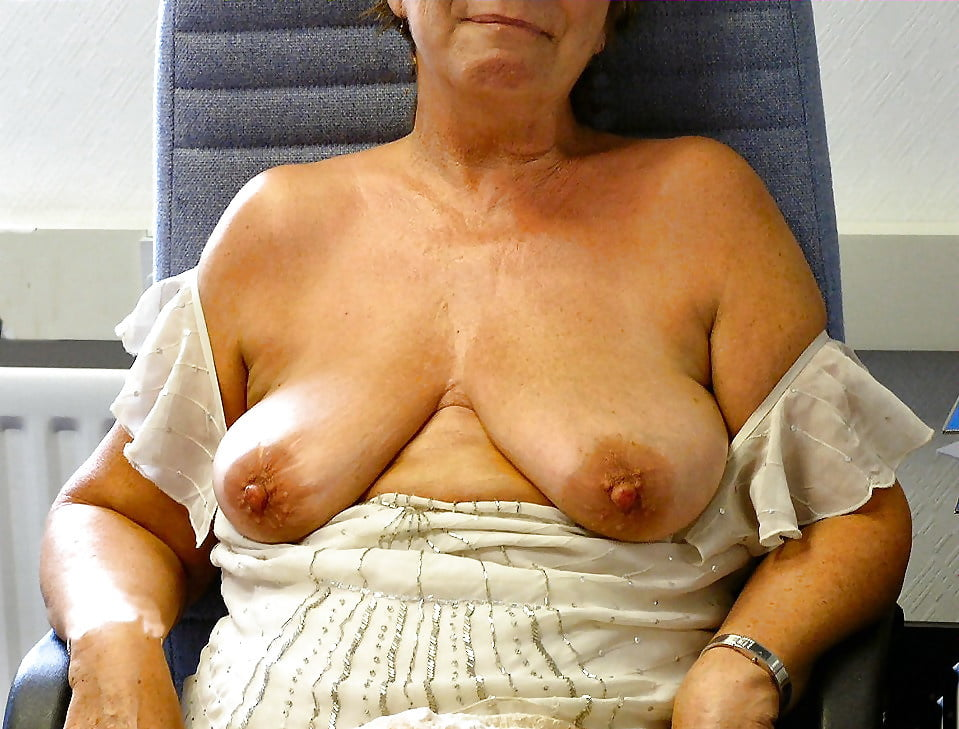 Granny in her seventies with huge breasts