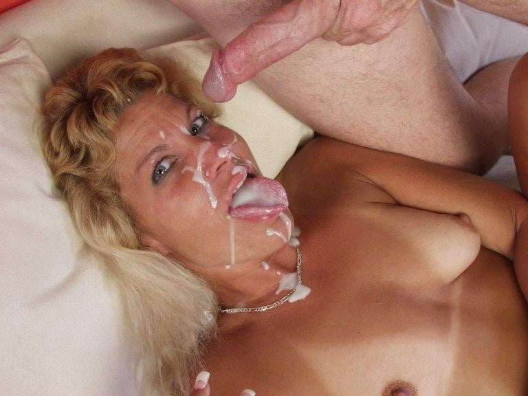 Horny busty milf gets yong dudes cum all over her face