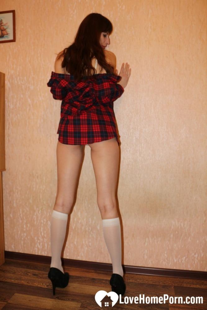 Beautiful schoolgirl showing her hot bod in heels