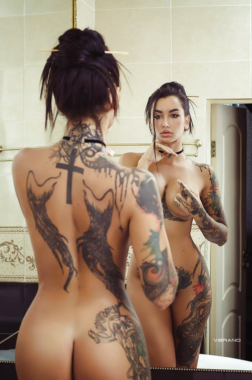 Naked girls with tattoos having sex