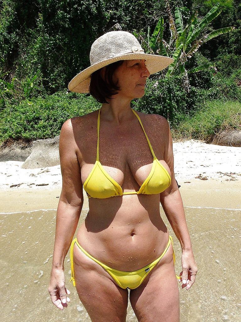 Mature Woman In Orange Bikini By Danil Nevsky