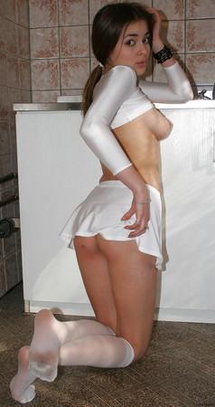 BRUNETTE TEEN IN WHITE DRESS