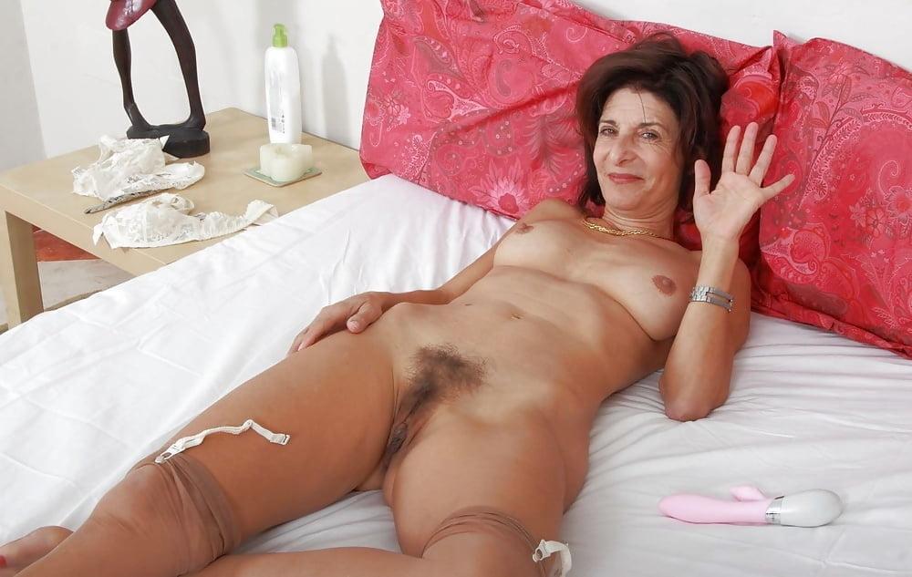 Older woman enjoys massage and anal sex