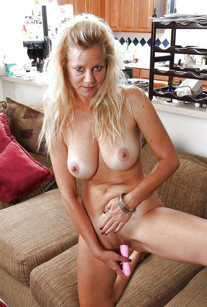 Mature blonde stripping