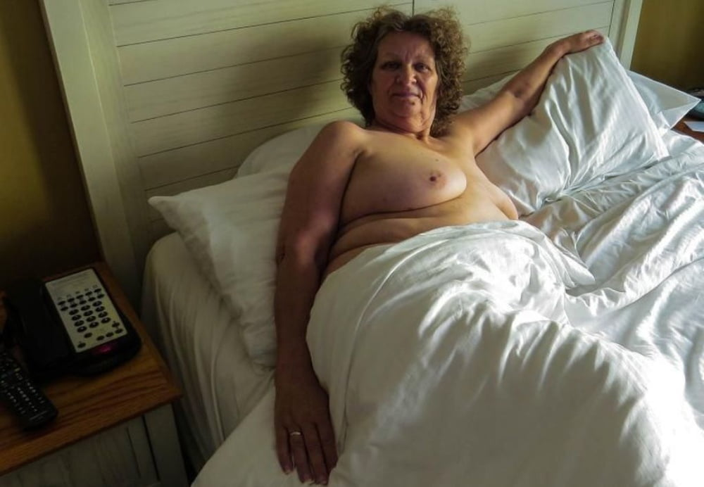 Curvy old wives showing off in a voyeur dressing room photo