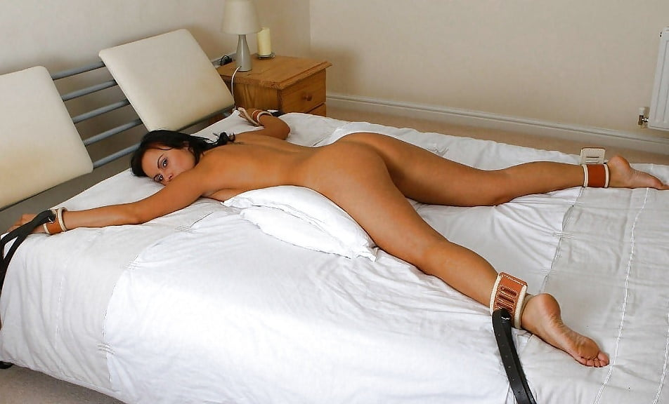Bondage rope tied to bed