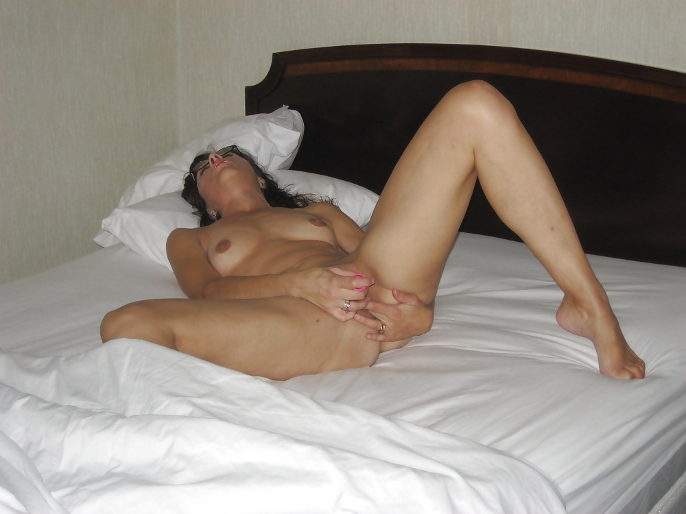 Wife Masturbates In Bed While Husband Naps