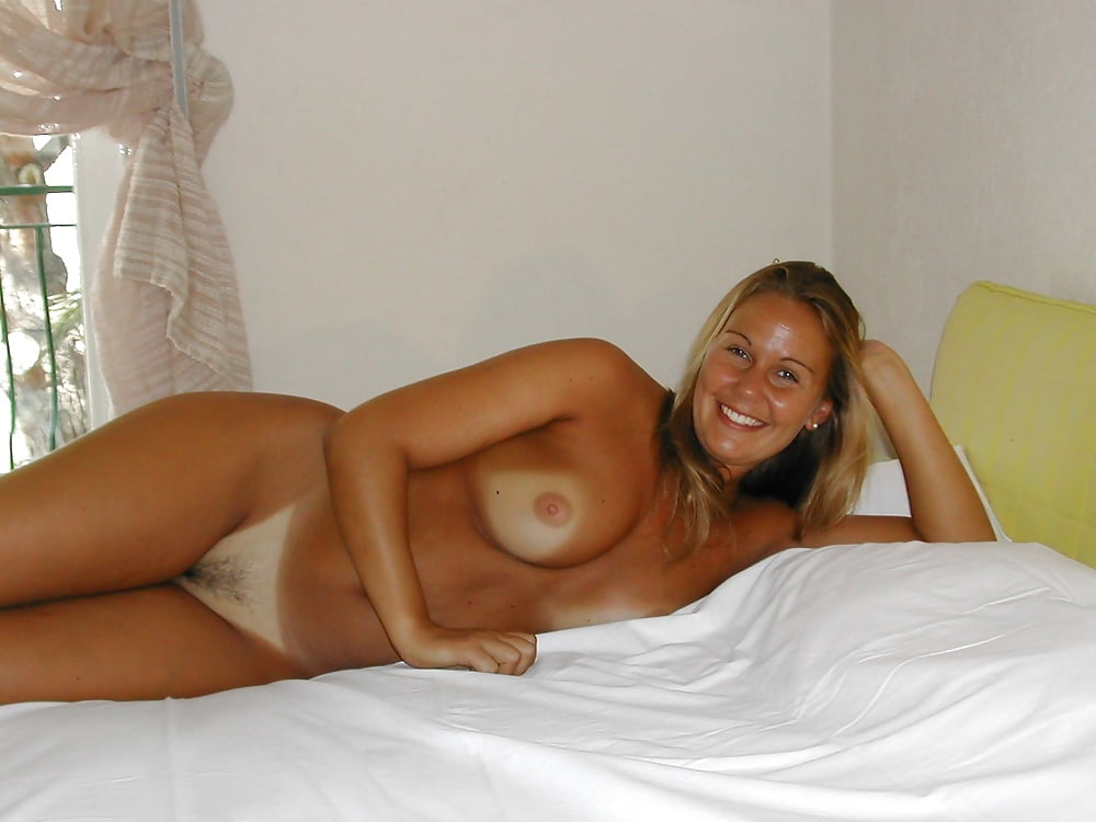 Soccer mom showing off her tanlines porn pic