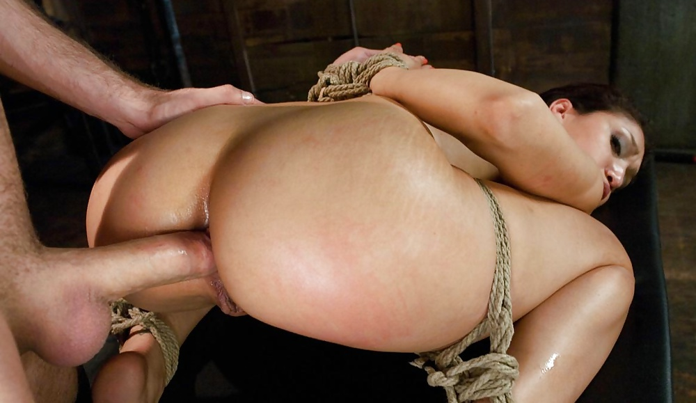 Tied up brunette anal fisted in dungeon