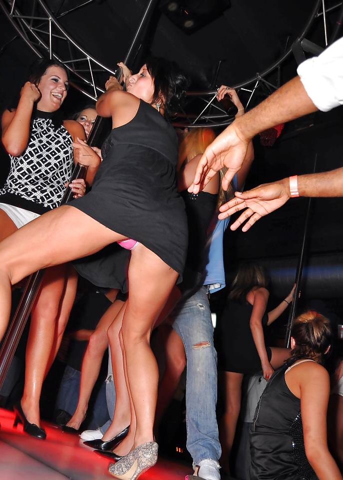 Upskirt girl in club dance video