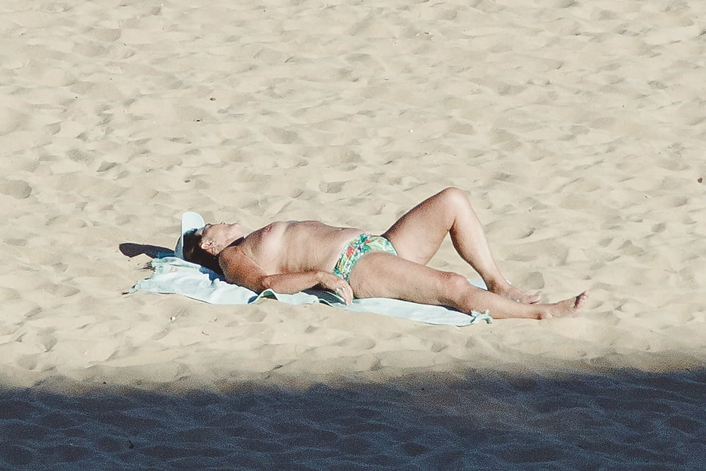 Naked old men on the beach-8580