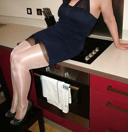 in the kitchen shiny stockings red suspenders and heels
