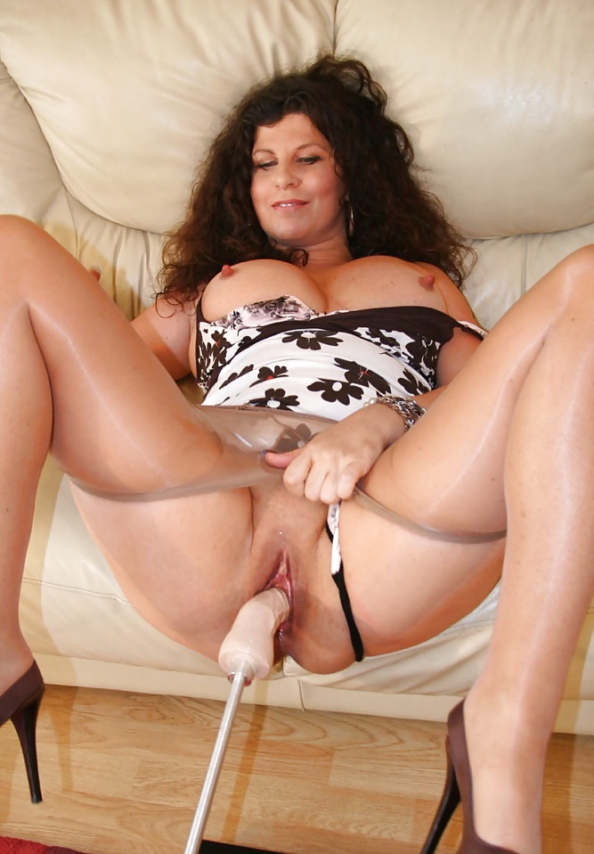 Mommy in pantyhose, naked angel sitting on a cliff