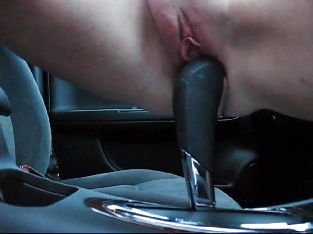 Hot Busty Babe On The Car Gear Shift