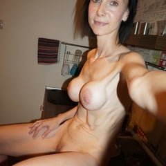 Skinny MILF Shows Off Her Fake Tits