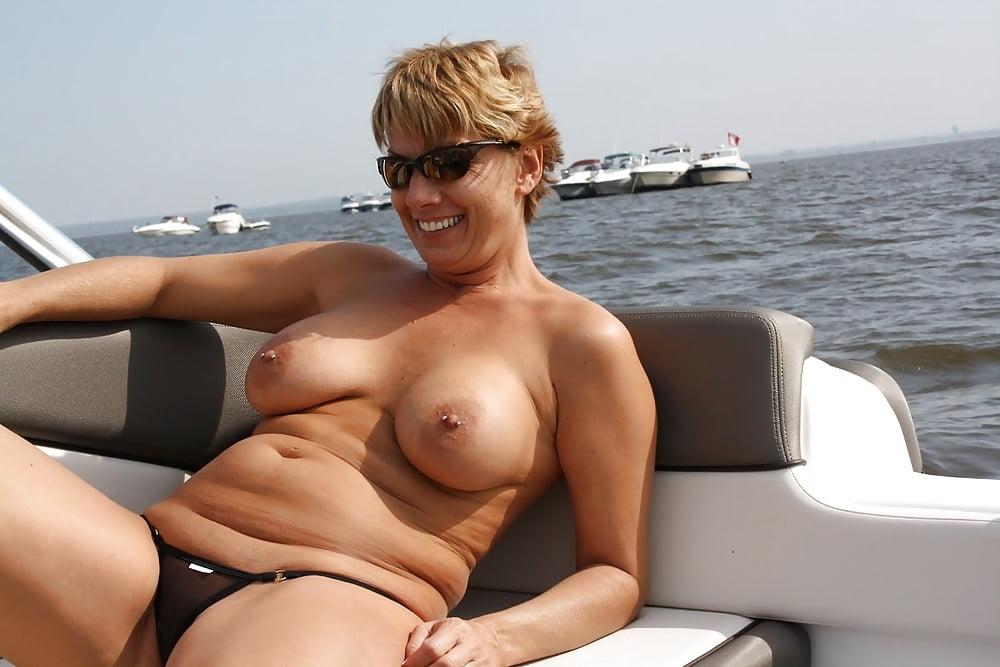 Portrait Of Mature Woman Wearing Bikini Stock Photo