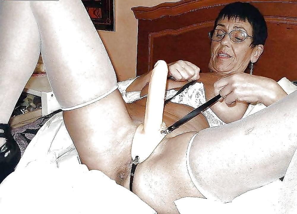 Buxom Blonde Fetish Model In Stripper Boots Slips Butt Plug Into Asshole