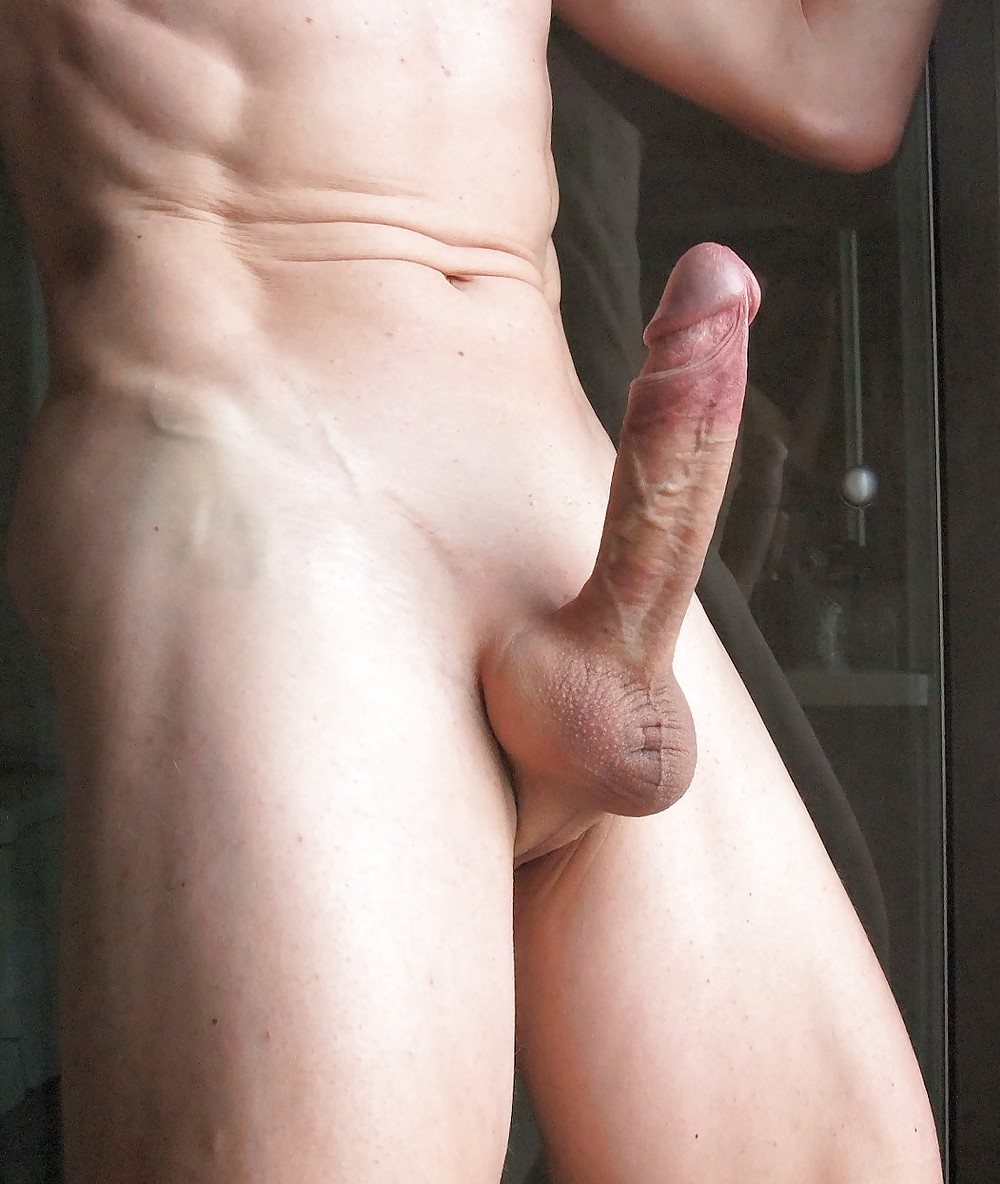 Naked boy with a soft uncut penis