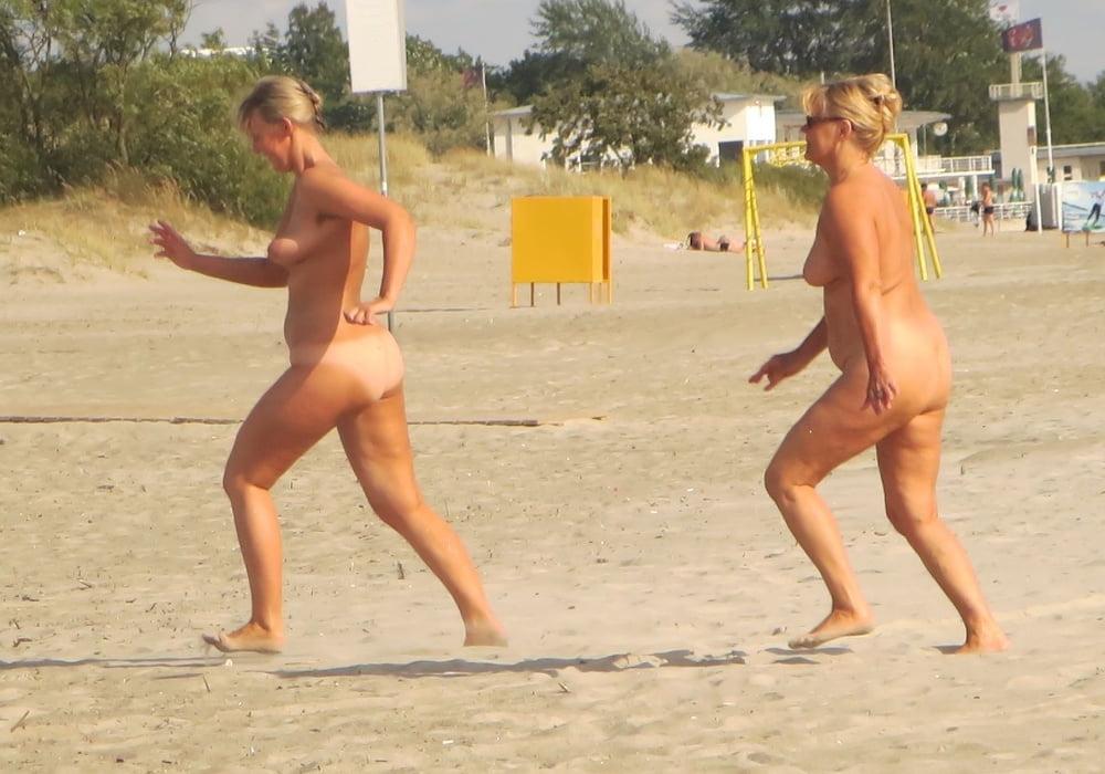 Naked girls running on the beach