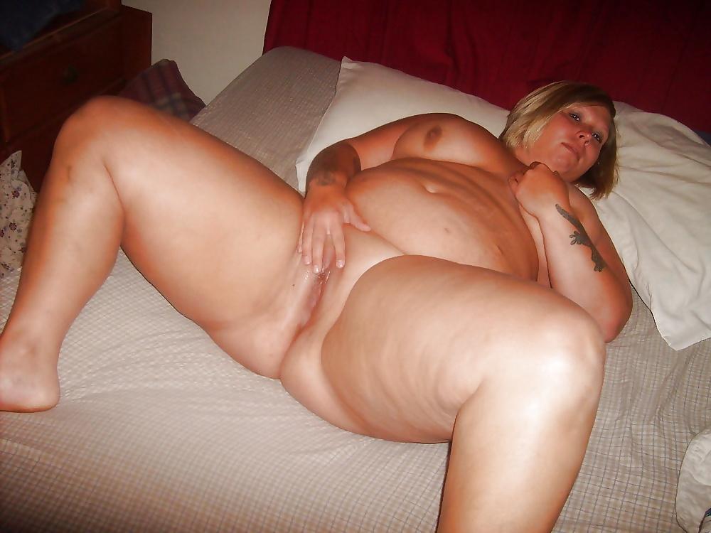 Beautiful blonde milf spreading her plump ass cheeks