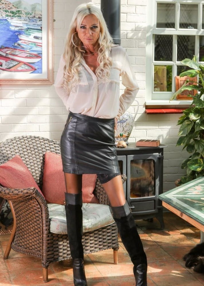 Blonde In A Leather Skirt Getting Ready 1
