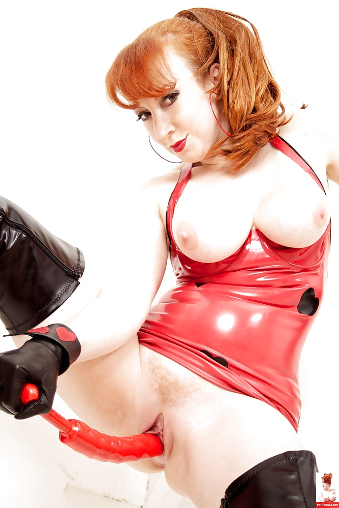 Sexy Red Head Done Up In Pink Latex Really What Yuvutu 1