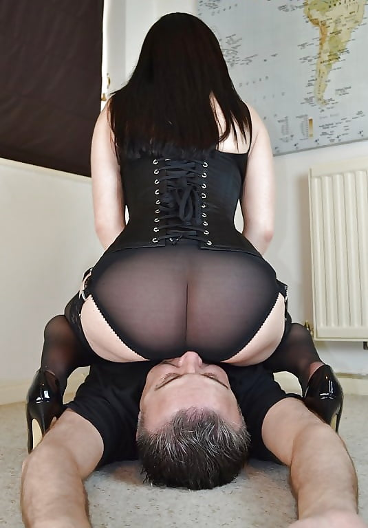 Femdom facesitting photo with mature booty mistress smothering the slave and forcing him to femdom ass licking pics
