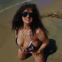 Hot Busty Beach Mature In String Beer Bikini