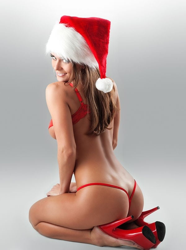Sexy santa's little helper with billboard stock photos