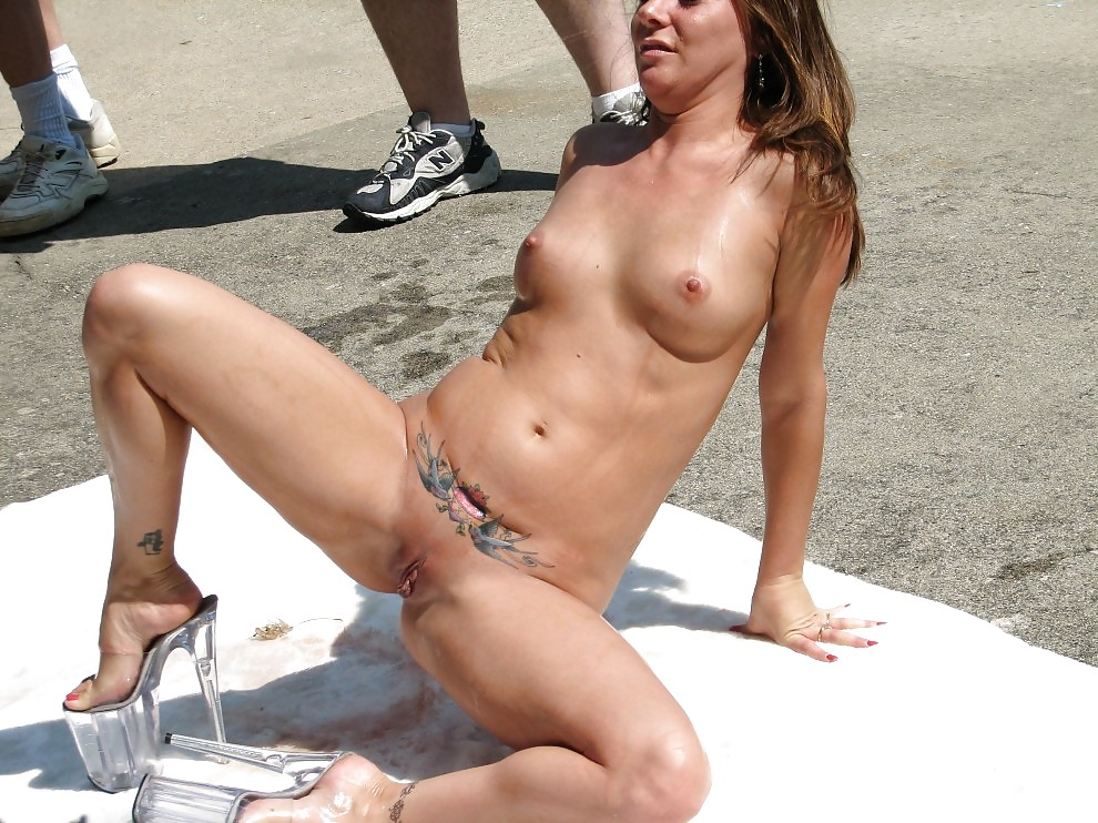 Nude chick washing her pussy on the street