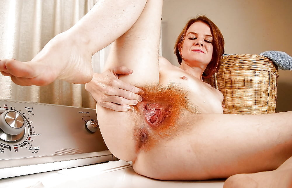 Long red hair and a very hairy red pussy too