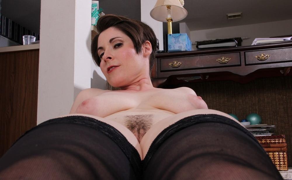 Busty mature babe sadie jones naked on her desk