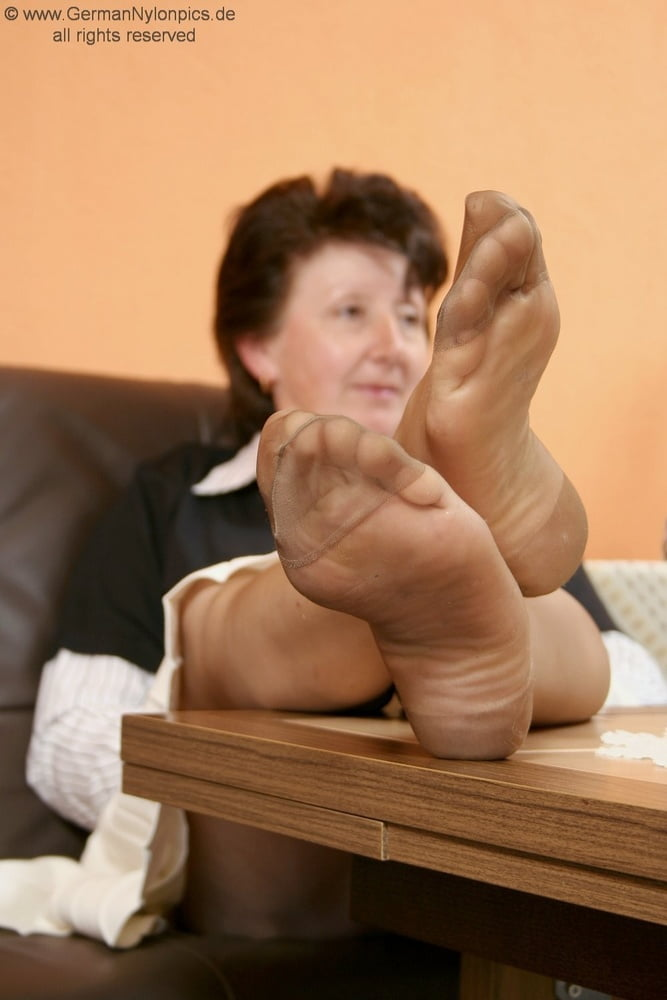 Mature feet in pantyhose having sex