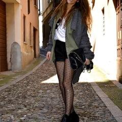 pretty girl posing in black stockings and heels