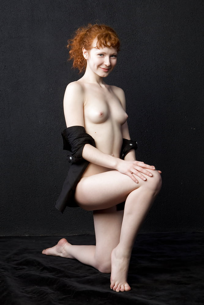 Petite redhead with big tits