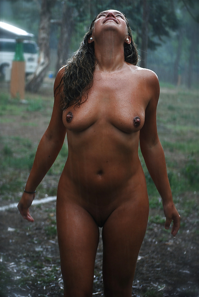 Young redhead girl adayn completely naked out in the rain