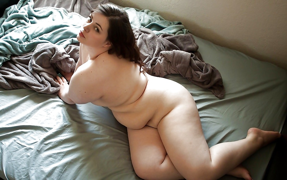 Fat naked woman sit on bed