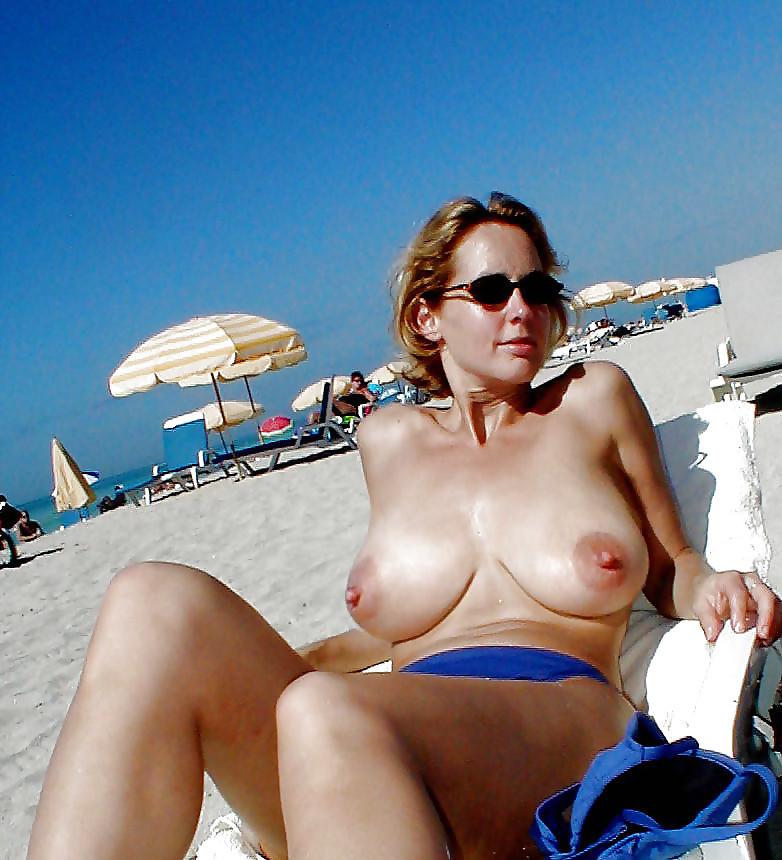 Busty topless mature beach