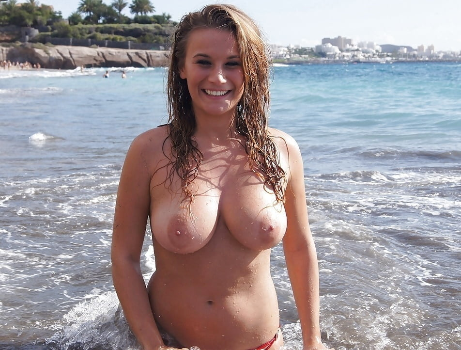 Smiling Brunette With Very Big Boobs Posing Topless