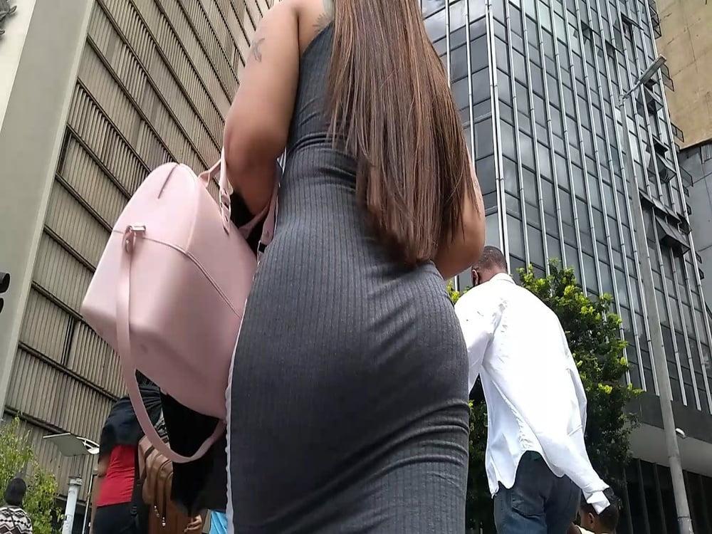 Hot brunette in gray dress - 7 Pics