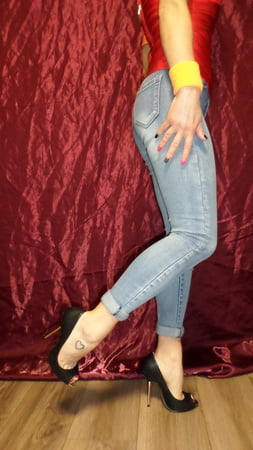 open toe shoes and worn jeans