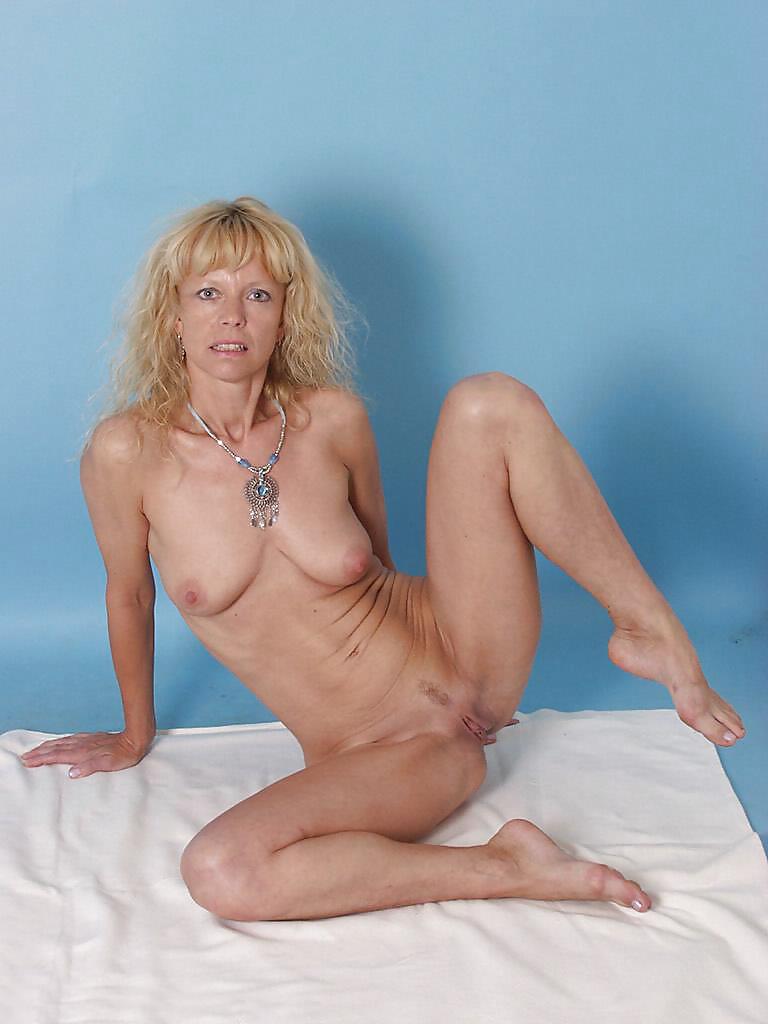 Mature Blonde Euro Slut Strips And Spreads - 14 Pics -1866